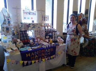 Hannah of Handmade Hannah Crafts tending the stall